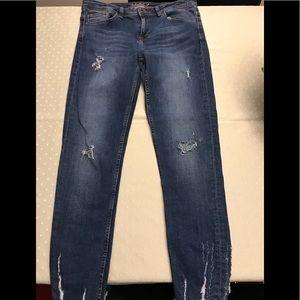 Zara basic ripped blue jeans.